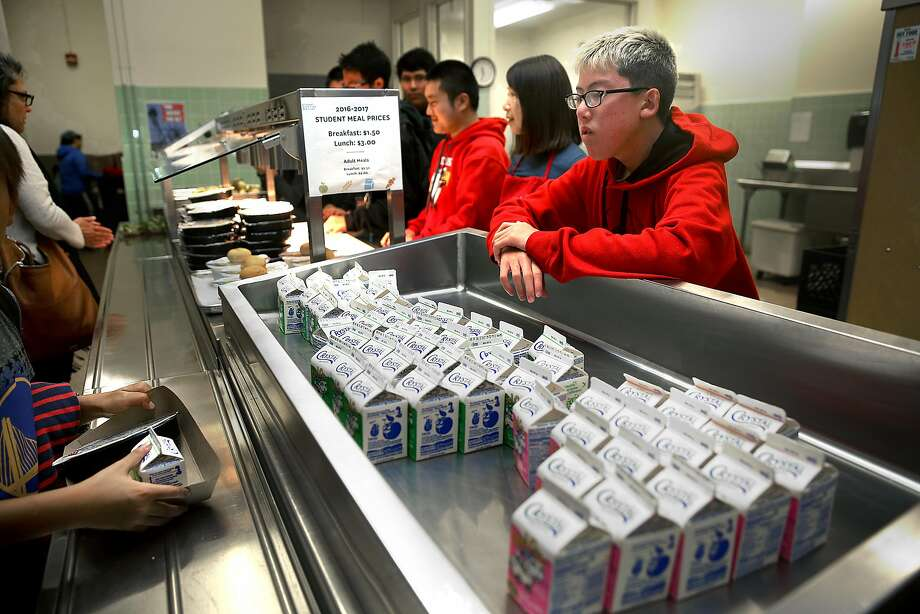 Elementary school students attending multigrade summer school at San Francisco's George Washington High School pick up plain milk to go with their lunches. Photo: Liz Hafalia, The Chronicle