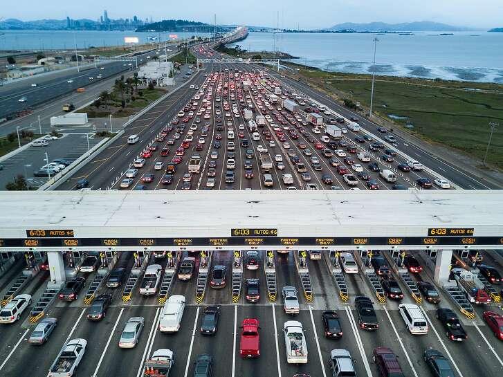 Traffic flows through the Bay Bridge toll plaza on Thursday, June 8, 2017, in Oakland, Calif.