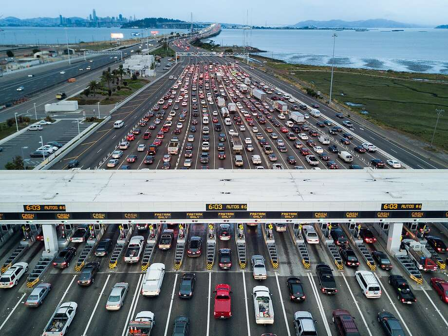 Traffic flows through the Bay Bridge toll plaza for the morning commute. Data from the Metropolitan Transportation Commission show traffic is starting much earlier than it used to.  Photo: Noah Berger, Special To The Chronicle