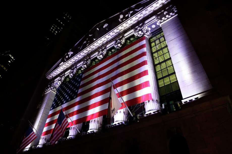 FILE - In this Friday, Feb. 17, 2017, file photo, an American flag hangs on the front of the New York Stock Exchange, after the markets closed. U.S. stocks are bouncing back early Friday, July 7, 2017, after the government said hiring grew at a stronger pace in June. Technology companies are making some of the biggest gains while energy companies decline with oil prices. A day earlier stocks took their biggest loss since mid-May following a disappointing measurement of hiring by private companies. (AP Photo/Peter Morgan, File) Photo: Peter Morgan, STF / Copyright 2017 The Associated Press. All rights reserved.