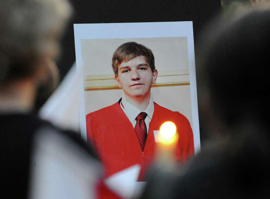 A photo of Bart Palosz during Vigil Prayer Service for Palosz at Greenwich High School, Tuesday night, Sept. 10, 2013. Palosz committed suicide after attending the first day of classes as a sophomore at Greenwich High school. The Palosz family says the suicide is the result of school bullying over a period of years. Photo: Bob Luckey / Bob Luckey / Greenwich Time