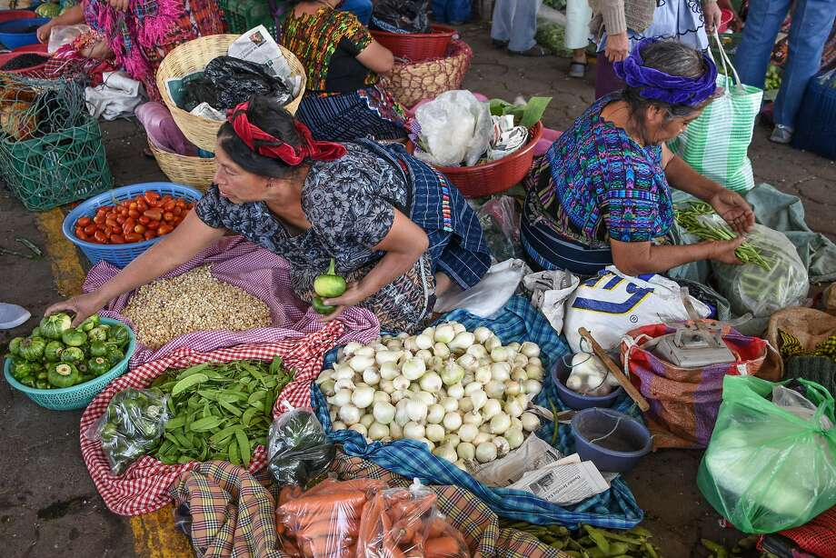 Vendors sell a vast variety of fresh, quality products at the bustling Antigua Mayan market. Photo: Margo Pfeiff, Special To The Chronicle