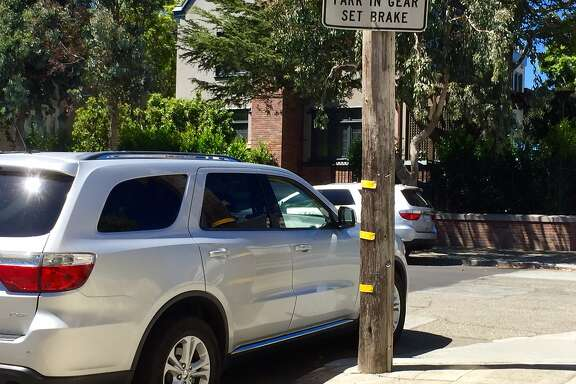 Guards in SUVs patrol outside Facebook founder Mark Zuckerberg's home in San Francisco's Dolores Heights.