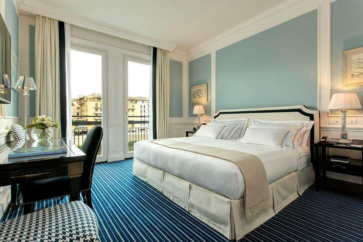Interior designer Michele Bonan chose blue and white hues for Florence�s Hotel Lungarno to reflect its riverside location and added 400 artworks to guest rooms and public spaces.