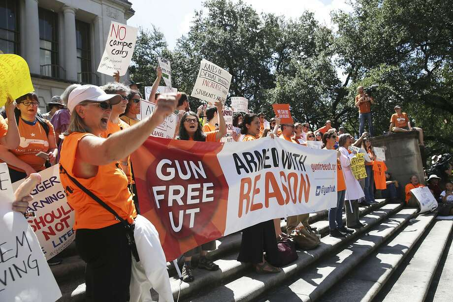 Participants gather on steps near a speaker as students stage a protest against new campus carry rules for firearms on August 24, 2016 Photo: TOM REEL, SAN ANTONIO EXPRESS-NEWS