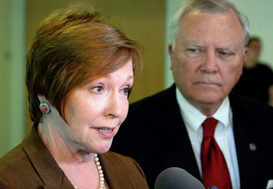 FILE - In this Thursday, Oct. 16, 2014 file photo, Brenda Fitzgerald, Georgia Department of Public Health commissioner, left, and Gov. Nathan Deal respond to questions about Ebola victims at Emory University Hospital and efforts to screen for Ebola among travelers passing through Hartsfield-Jackson International Airport during the governor's visit to Georgia Tech, in Atlanta. On Friday, July 7, 2016, Fitzgerald was named to lead the U.S. Centers for Disease Control and Prevention, the federal government's top public health agency. (AP Photo/David Tulis) Photo: David Tulis, FRE / FR170493 AP