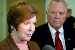 FILE - In this Thursday, Oct. 16, 2014 file photo, Brenda Fitzgerald, Georgia Department of Public Health commissioner, left, and Gov. Nathan Deal respond to questions about Ebola victims at Emory University Hospital and efforts to screen for Ebola among travelers passing through Hartsfield-Jackson International Airport during the governor's visit to Georgia Tech, in Atlanta. On Friday, July 7, 2016, Fitzgerald was named to lead the U.S. Centers for Disease Control and Prevention, the federal government's top public health agency. (AP Photo/David Tulis)