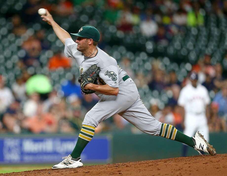 Oakland Athletics starting pitcher Chris Smith (56) pitches during the sixth inning of an MLB game at Minute Maid Park, Monday, Aug. 29, 2016, in Houston.  ( Jon Shapley / Houston Chronicle ) Photo: Jon Shapley, Houston Chronicle