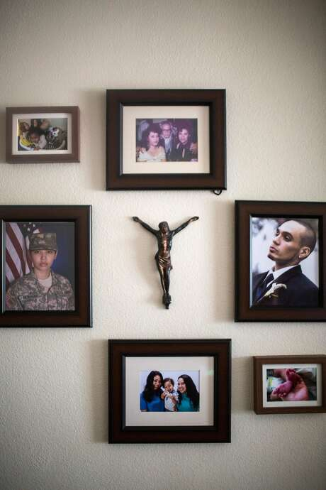 Photographs hang on the living room wall where Morales lives with her mom and son in Los Angeles. She is opposed to SB421. Photo: Dania Maxwell, Special To The Chronicle