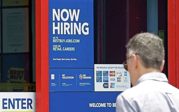 A hiring sign welcomes a customer entering a Best Buy store in Hialeah, Fla. U.S. employers added a robust 222,000 jobs in June, the most in four months.