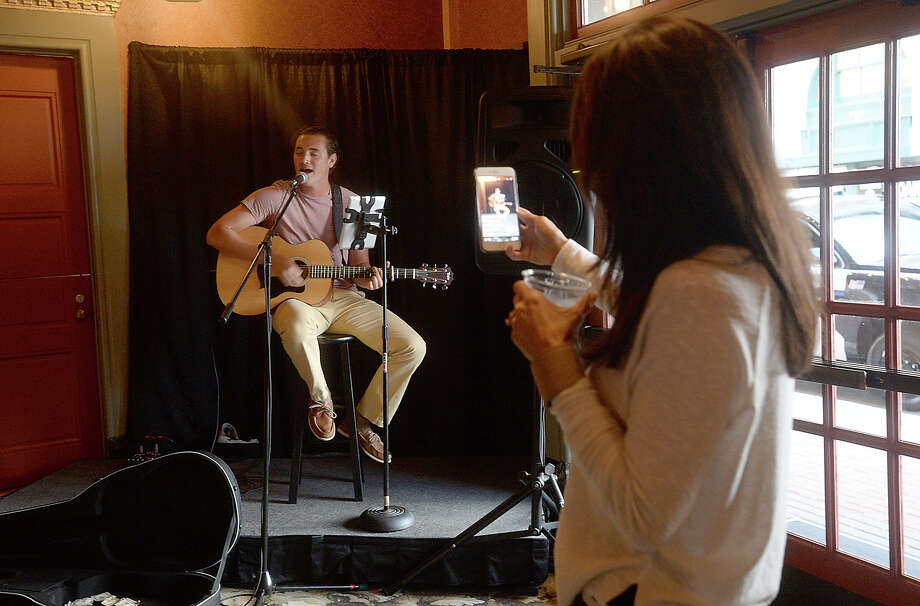 Kay Walker takes video as her son Christian Walker performs during the social hour before the showing of Top Gun at the Jefferson Theatre's Classic Movie Night Friday. Photo taken Friday, July, 7, 2017 Kim Brent/The Enterprise Photo: Kim Brent / BEN