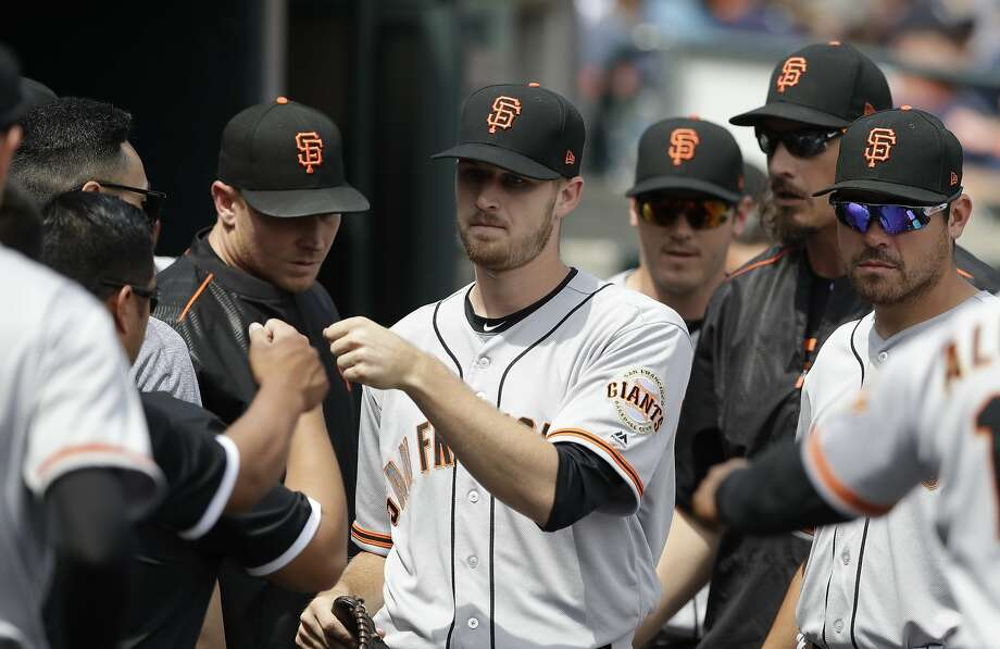 San Francisco Giants starting pitcher Chris Stratton is greeted by teammates after being relieved in the seventh inning of a baseball game against the Detroit Tigers, Thursday, July 6, 2017, in Detroit. (AP Photo/Carlos Osorio) Photo: Carlos Osorio, Associated Press