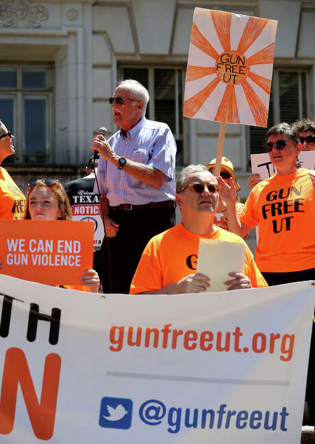A group calling itself Gun Free UT protests the campus carry law on the steps of the main building (tower) on the University campus Wednesday August 4, 2016. Peaking with the group is U.T. government professor Brian Jones. Photo: John Davenport, Staff / ©San Antonio Express-News/John Davenport
