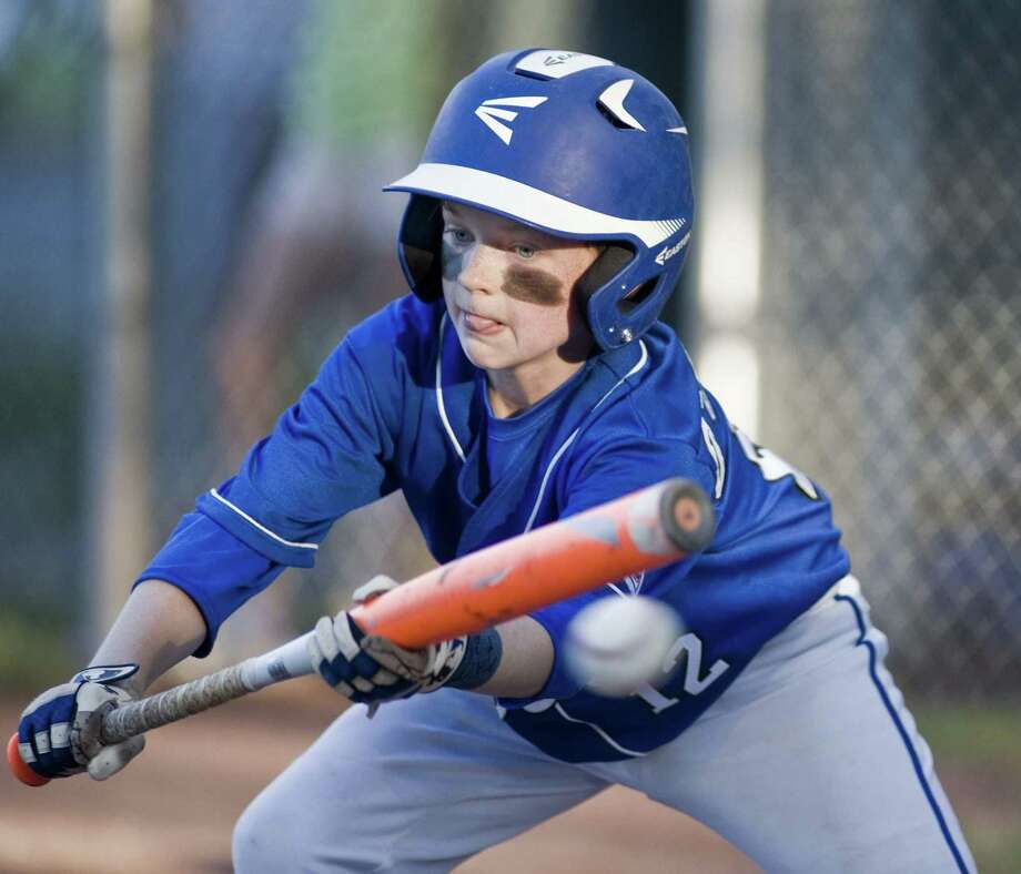 Darien's Luke O'Connell squares to bunt in the District 1 Little League playoffs against Stamford National, played at Scalzi Park in Stamford on Friday. Darien won 8-7 to eliminate Stamford National. Photo: Scott Mullin / For Hearst Connecticut Media / The News-Times Freelance