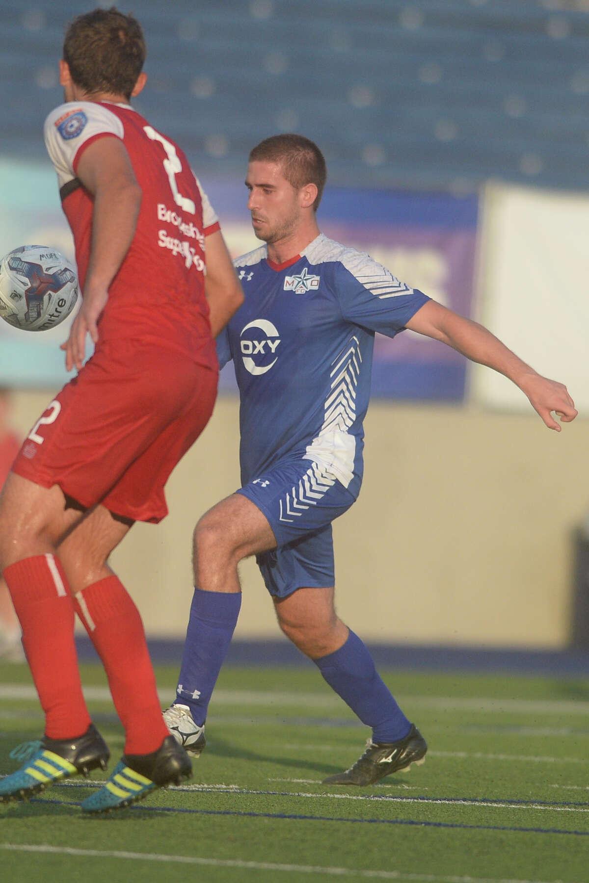 Midland-Odessa FC's Jamie O'Grady (16) kicks against Tyler FC on Friday, July 7, 2017, at Grande Communications Stadium. James Durbin/Reporter-Telegram