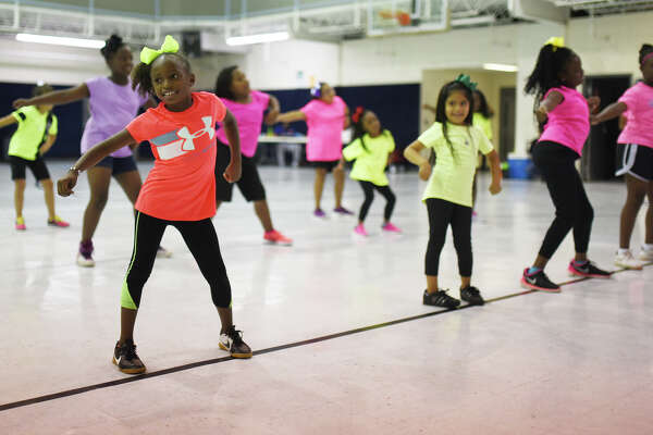 Camp participants put on a show after a week of cheerleading camp Friday, July 7, 2017, at the Greater Ideal Life Center. James Durbin/Reporter-Telegram