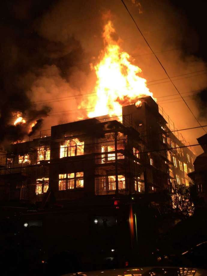 A fire set at a three-story development east of Lake Merritt in Oakland last October was determined for the first time Friday by federal investigators to have been intentionally set. Photo: Special To The Chronicle / Noah Berger