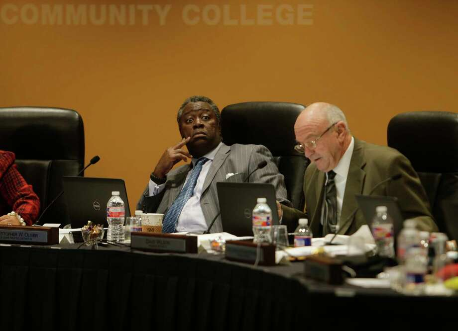 Houston Community College Board of Trustees member Christopher Oliver, left, participates in Thursday's board meeting, Jan. 19, 2017, in downtown Houston. Photo: Houston Chronicle / © 2017 Houston Chronicle