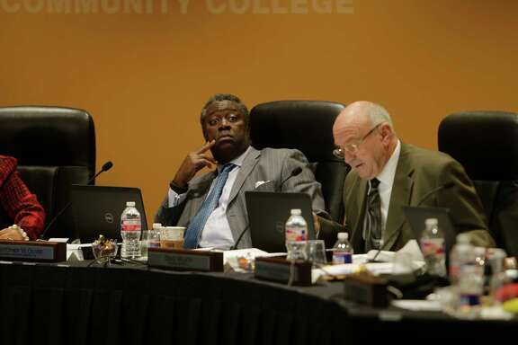 Houston Community College Board of Trustees member Christopher Oliver (left) and Dave Wilson (right) participate in Thursday's board meeting, Jan. 19, 2017, in downtown Houston.