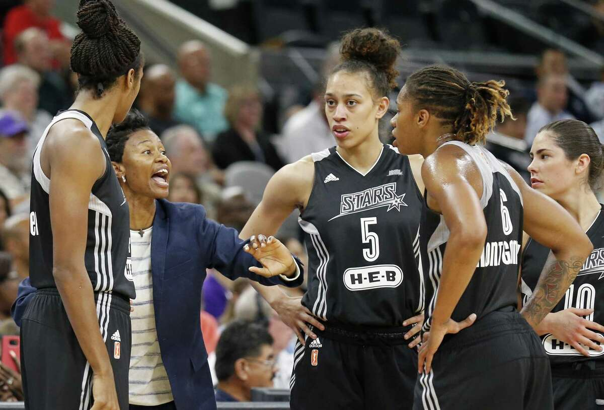 San Antonio Stars head coach Vickie Johnson (center) huddles with the team, during a timeout in first half action against the Phoenix Mercury Friday July 7, 2017 at the AT&T Center.