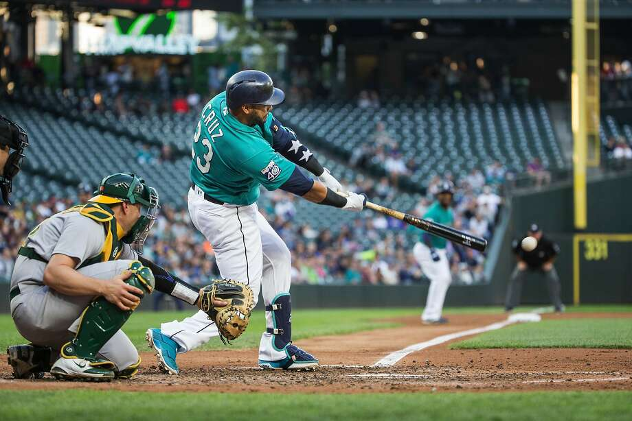 The Seattle Mariners' Nelson Cruz connects for an RBI single in the third inning against the Oakland Athletics on Friday, July 7, 2017, at Safeco Field in Seattle. (Dean Rutz/Seattle Times/TNS) Photo: Dean Rutz, TNS