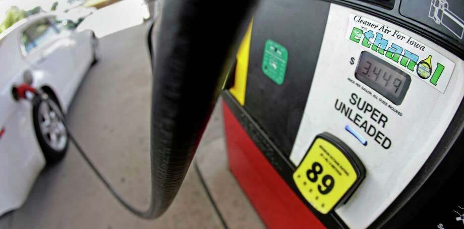 A motorist fills up with gasoline containing ethanol in Des Moines.  Photo: Charlie Riedel, STF / AP2013