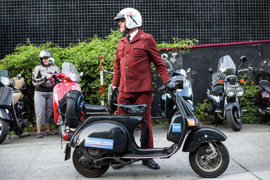 David Berg of Salt Lake City pulls up to the Amerivespa Seattle party on his Bajaj, a Vespa off-shoot in India, on Friday, July 7, 2017. Photo: GRANT HINDSLEY, SEATTLEPI.COM / SEATTLEPI.COM