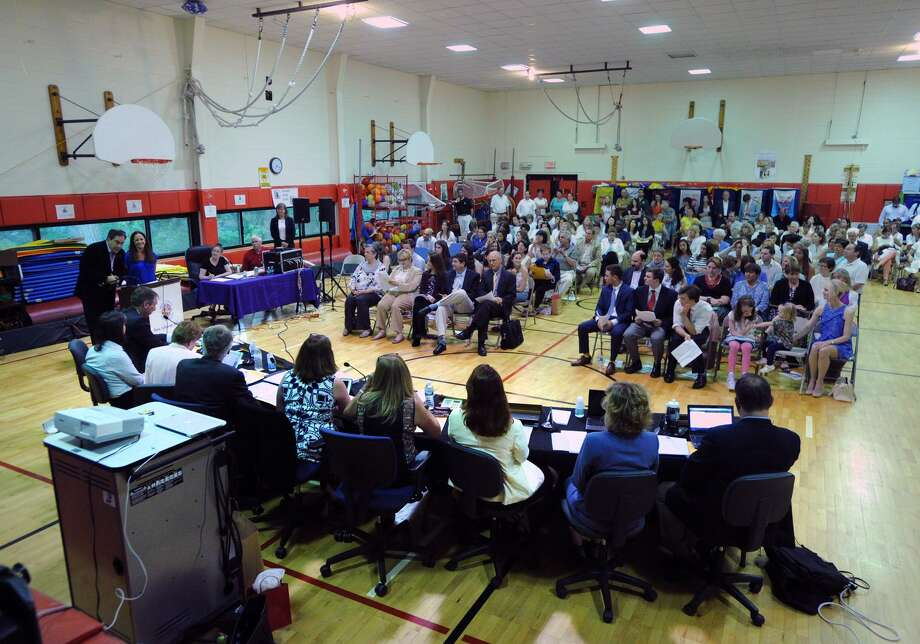 The final Greenwich Board of Education meeting of the school year that was held in the New Lebanon School gym in the Byram section of Greenwich, Conn., Tuesday night, June 14, 2016. Races for this year's board elections in November are shaping up. Photo: Bob Luckey Jr. / Hearst Connecticut Media / Greenwich Time