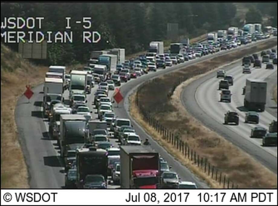 Traffic was backed up at least 7 miles on Interstate 5 southbound near Lacey Saturday morning after state troopers shot a man who threatened them with a knife. Photo: WSDOT