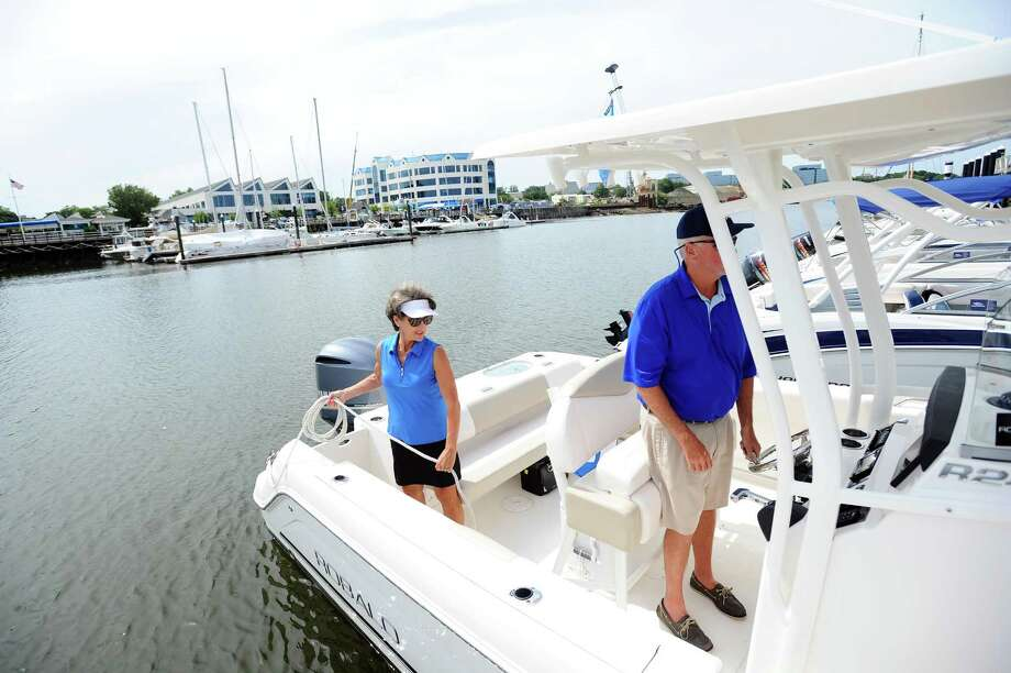 Harbor Point residents and Carefree Boat Club members Barbara Simms, left, and husband Larry pull their boat out onto the Long Island Sound in Stamford, Conn. on Thursday, July 6, 2017. Photo: Michael Cummo / Hearst Connecticut Media / Stamford Advocate