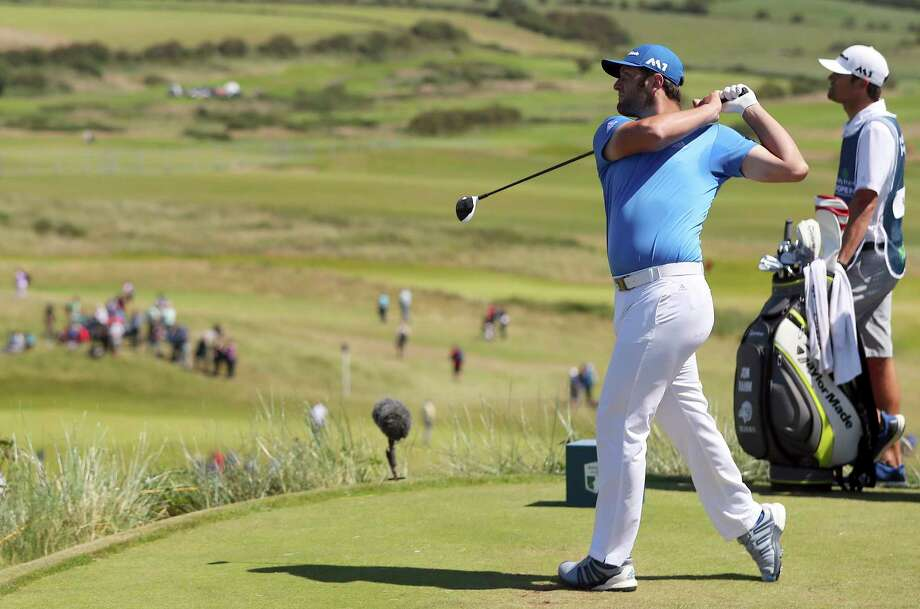 Spain's Jon Rahm on the 8th tee during day three of the Irish Open at Portstewart Golf Club, Northern Ireland, Saturday July 8, 2017.  The 11th ranked Rahm shot a second straight 5-under 67 at the Irish Open and moved into a share of the lead with Daniel Im in the third round on Saturday. (Niall Carson/PA via AP) Photo: Niall Carson, SUB / PA Wire