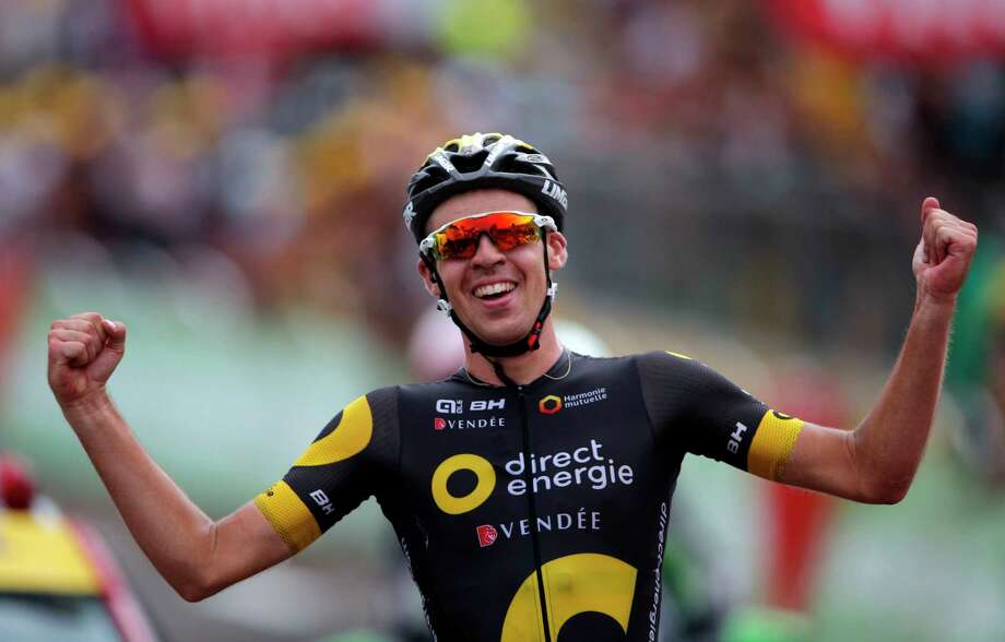 France's Lilian Calmejane celebrates as he crosses the finish line to win the eighth stage of the Tour de France cycling race over 187.5 kilometers (116.5 miles) with start in Dole and finish in Station des Rousses, France, Saturday, July 8, 2017. (AP Photo/Christophe Ena) Photo: Christophe Ena, STF / Copyright 2017 The Associated Press. All rights reserved.