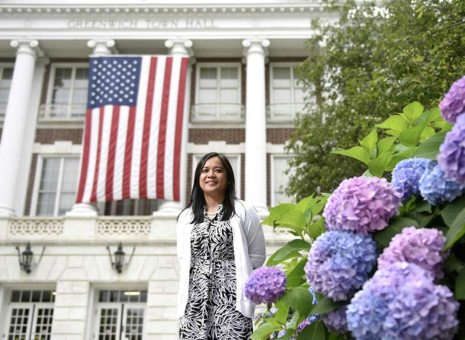 Town of Greenwich Head of Community Development Princess Erfe poses outside Town Hall in Greenwich, Conn. Thursday, July 6, 2017. After18 years working in Town Hall, Erfe will soon be leaving her job in Greenwich to head to upstate New York. Photo: Tyler Sizemore / Hearst Connecticut Media / Greenwich Time