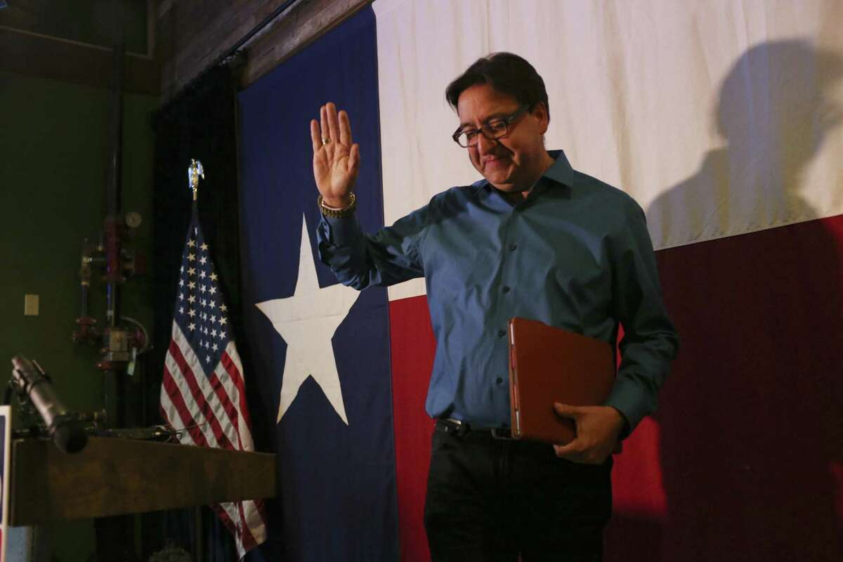 U.S. District 23 democratic candidate Pete Gallego waves as he leaves the stage after conceding the race against Republican incumbent Will Hurd, Wednesday, Nov. 9, 2016.