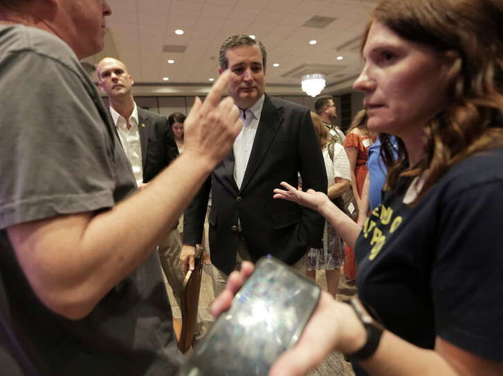 U.S. Sen. Ted Cruz talks with concerned citizens after an event at Sheraton Brookhollow Hotel  on Saturday, July 8, 2017, in Houston.