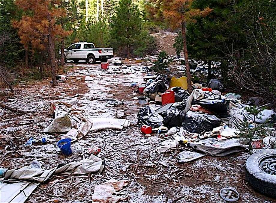 Volunteers picked up six truckloads of trash dumped by transients camping illegally at a closed location in national forest Photo: Tom Stienstra, Photo Courtesy Shasta-Trinity National Forest / Special To The Chronicle