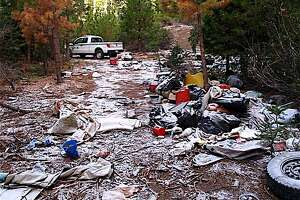 Volunteers picked up six truckloads of trash dumped by transients camping illegally at a closed location in national forest