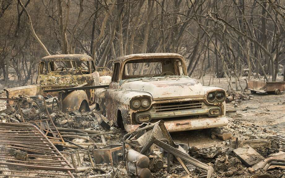Vintage trucks were burned by the Wall Fire near Oroville (Butte County). Photo: Noah Berger, Associated Press