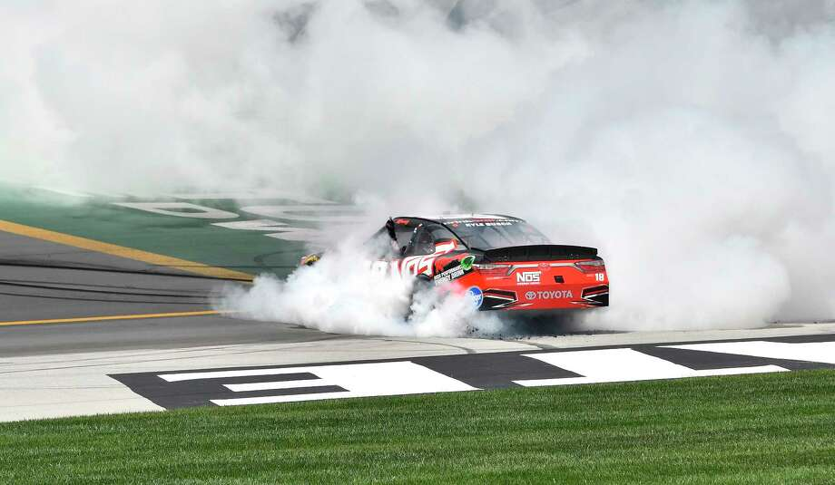 Xfinity Series driver Kyle Busch (18) blows his left rear tire as he does a burnout after his victory in the NASCAR Xfinity auto race at Kentucky Speedway, Saturday, July 8, 2017, in Sparta, Ky. (AP Photo/Timothy D. Easley) Photo: Timothy D. Easley, FRE / FR43398 AP
