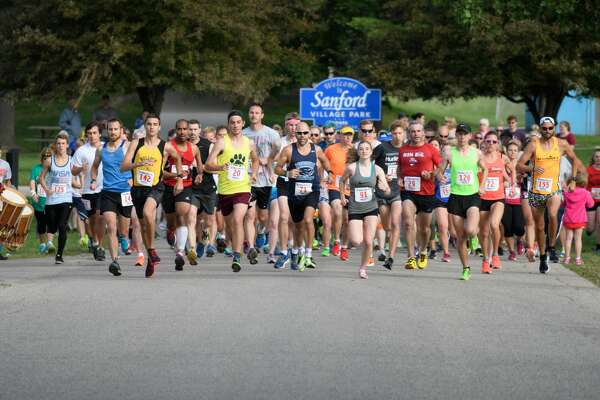 The start of the 77th Annual Coach Cole 5k in Sanford Saturday. (Steven Simpkins/for The Daily News)