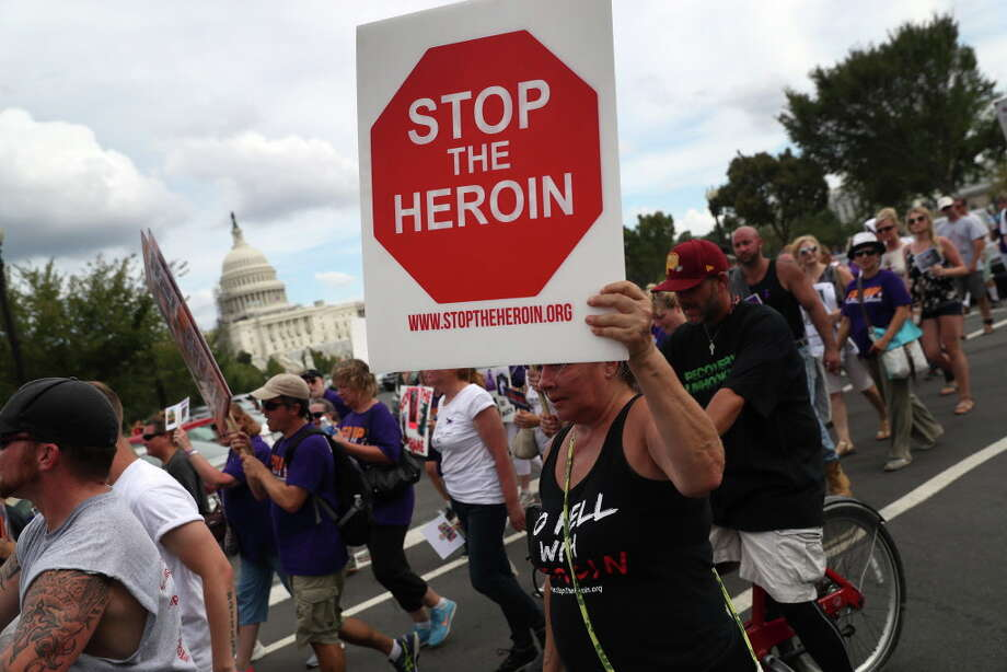 "WASHINGTON, DC - SEPTEMBER 18:  Activists and family members of loved ones who died in the opioid/heroin epidemic march in a ""Fed Up!"" rally at Capitol Hill on September 18, 2016 in Washington, DC. Protesters called on legistlators to provide funding for the Comprehensive Addiction and Recovery Act, which Congress passed in July without funding. Some 30,000 Americans die each year due to heroin and painkiller pill addiciton in the United States.  (Photo by John Moore/Getty Images) ORG XMIT: 668976487 Photo: John Moore / 2016 Getty Images"