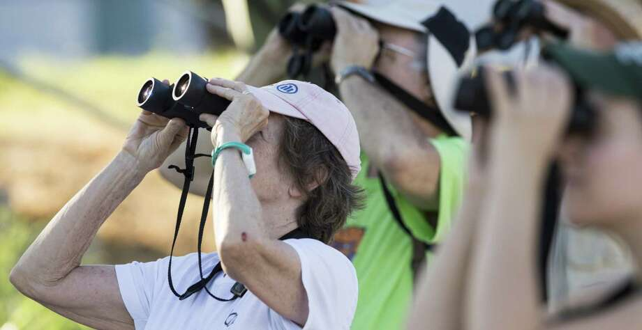 Janis Hydak attends an early morning beginner's bird walk at Judson Nature Trails in Alamo Heights lead by San Antonio Audubon Society's tour guide Georgina Schwartz.   Carlos Javier Sanchez / For The Express News Photo: Carlos Javier Sanchez / For The Express News / Carlos Javier Sanchez | Pixelreflex.com / pixelreflex.com