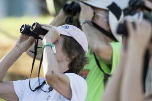 Janis Hydak attends an early morning beginner's bird walk at Judson Nature Trails in Alamo Heights lead by San Antonio Audubon Society's tour guide Georgina Schwartz.   Carlos Javier Sanchez / For The Express News