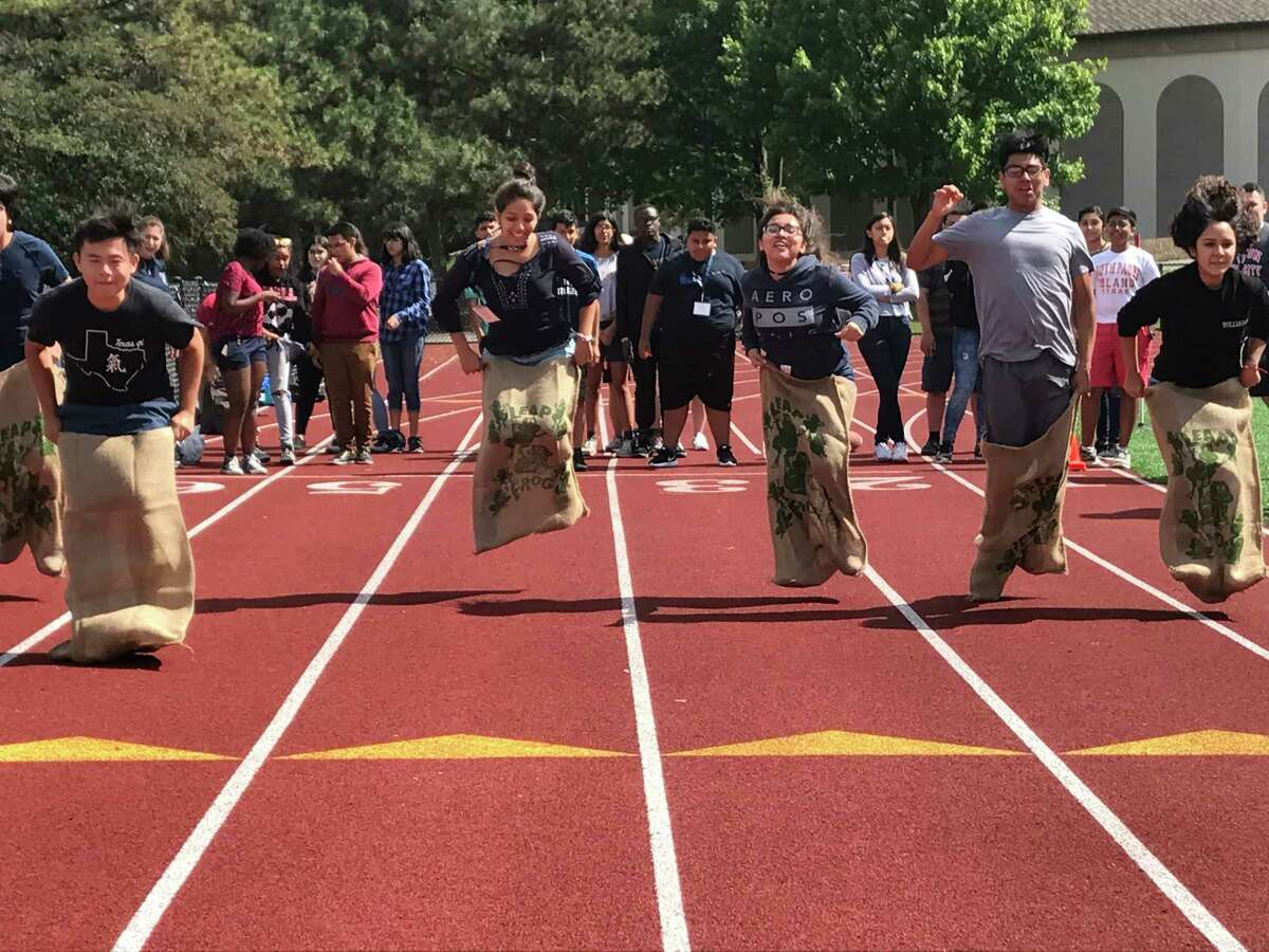 Students from Houston's EMERGE Fellowship compete in a potato sack race at Union College in Schenectady, N.Y.
