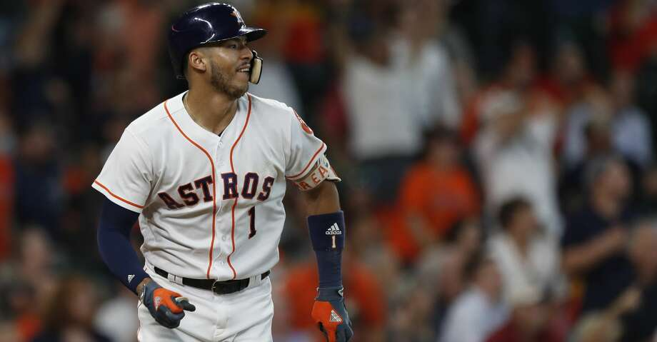 Houston Astros Carlos Correa (1) watches his second home run of the day leave the field during the sixth inning of an MLB baseball game at Minute Maid Park, Thursday, June, 29, 2017. ( Karen Warren / Houston Chronicle ) Photo: Karen Warren/Houston Chronicle