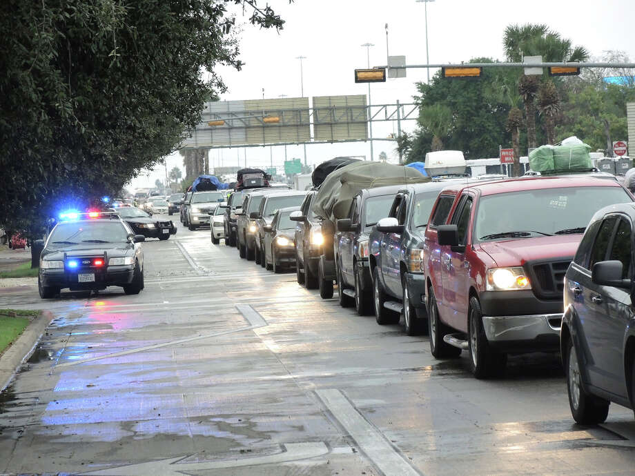 In this file photo, Laredo police units block intersections near the downtown area as south bound traffic heads toward the Juarez-Lincoln International Bridge. Photo: Cuate Santos/Laredo Morning Times