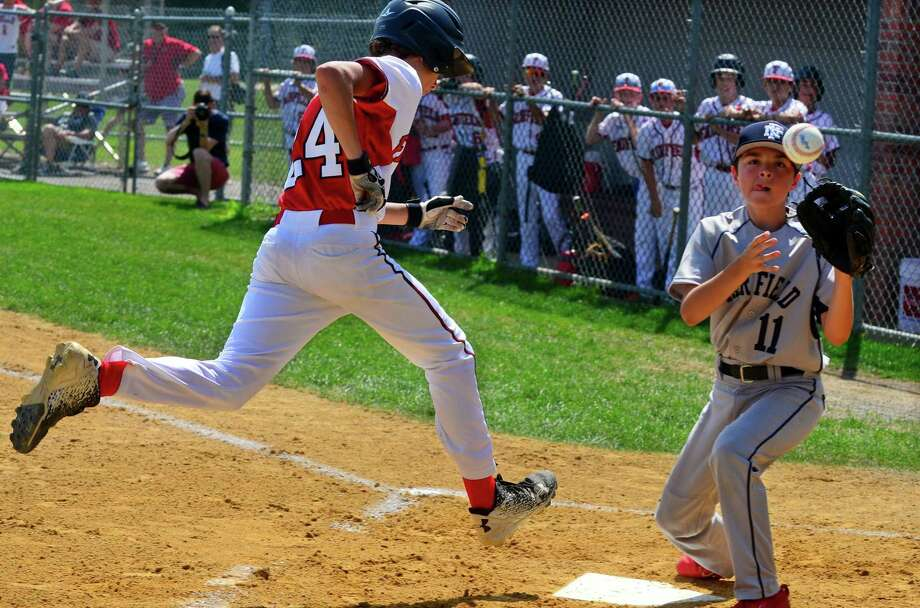 Fairfield American's Michael Ianazzo reaches home plate as Fairfield National pitcher Jake Harmony tries to make the tag during District 2 little league baseball action at Unity Park in Trumbull, Conn., on Saturday July 8, 2017. Photo: Christian Abraham / Hearst Connecticut Media / Connecticut Post