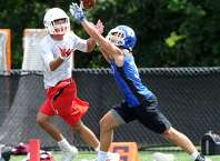 Greenwich receiver Jael Negron tries to haul in a pass that is broken up by a Darien defender during the Grip It & Rip It tournament in New Canaan on Saturday.