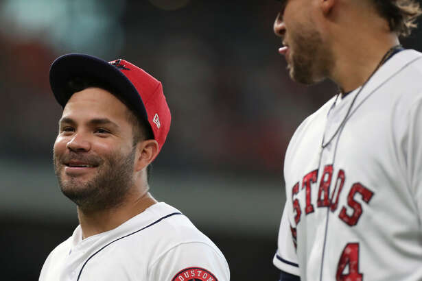 Houston Astros second baseman Jose Altuve (27) and center fielder George Springer (4) have a good conversation between top and bottom third inning of the game against the New York Yankees at Minute Maid Park Sunday, July 2, 2017, in Houston. (Yi-Chin Lee / Houston Chronicle)