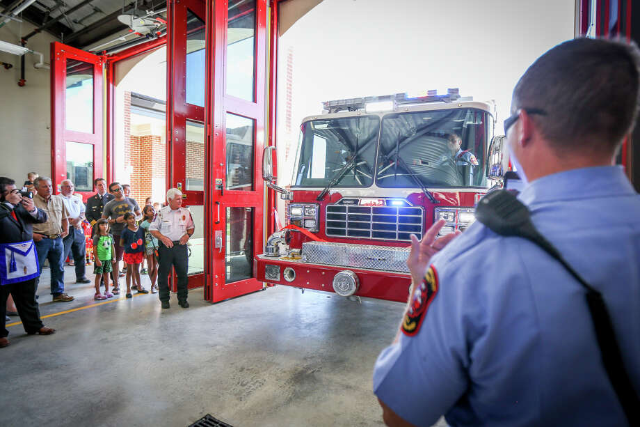 A fire truck drives through the grand opening ribbon, in South Montgomery Fire Department tradition, for their sixth fire station on Saturday off of Discovery Creek Boulevard in Spring. Photo: Michael Minasi, Staff Photographer / © 2017 Houston Chronicle